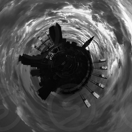 black circular machine in the middles of swirling black clouds photo