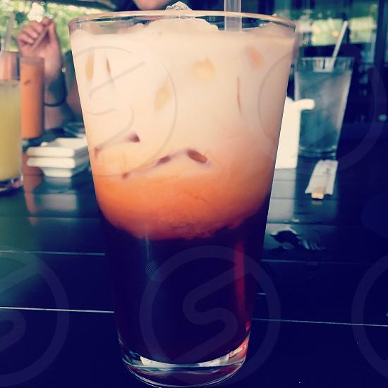 Thai iced tea milk bread ice glass afternoon sun photo