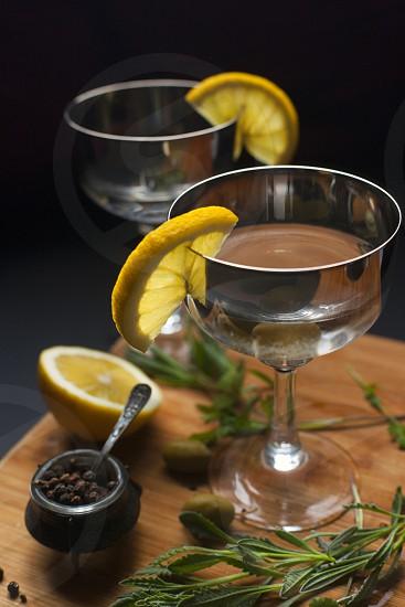 Glasses of gin lavender corriander olivesblack pepper photo