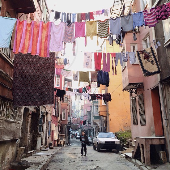 Out to dry - a view of organized  and chaotic laundry drying from the streets of Istanbul Turkey.  photo