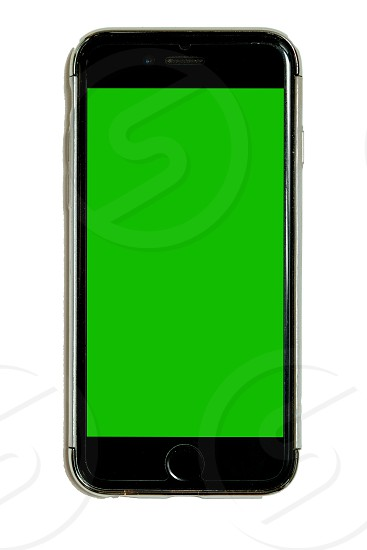 Smart phone in protective case with green chroma key touchscreen isolated on white background cell mobile phone adaptable for mockups and design large resolution photo