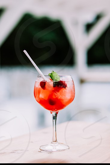 Close up of a red cocktail in a glass photo