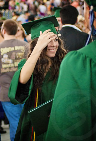 Happy beautiful girl with hat and gown graduates at ceremony graduation photo