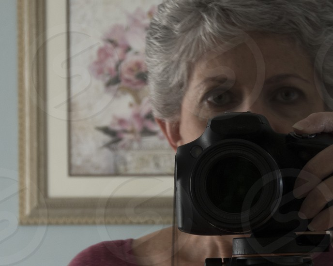 Self-Portrait - a camera-shy photographer photo