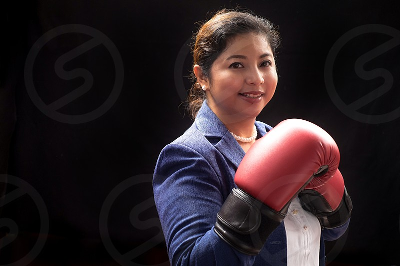 woman with boxing gloves in standing in orthodox position photo