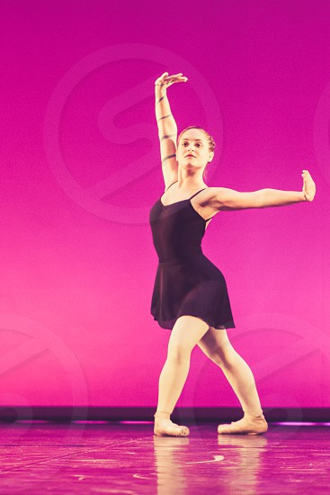 Modern Woman Dancer On Stage In Pink Background photo
