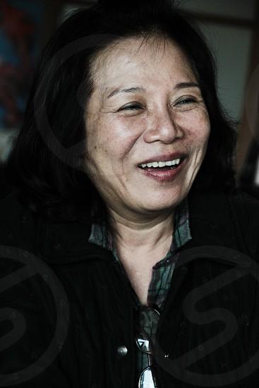 Older asian lady smiling  photo