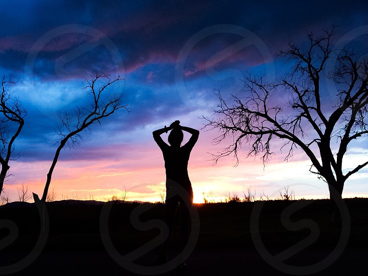 woman silhouette under the sunset photo