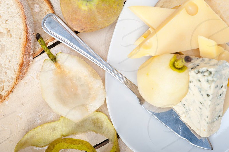 selection of cheese and fresh pears appetizer snack photo