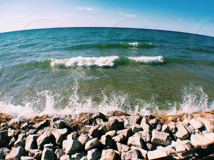 Lake Michigan • Ludington • Michigan • beach • waves • blue • water • rocks • gray  photo