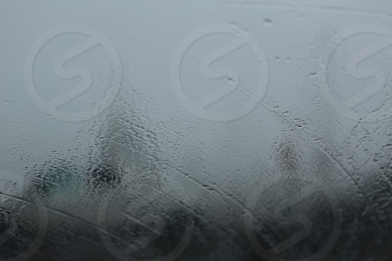 Rain hitting hard against a window photo