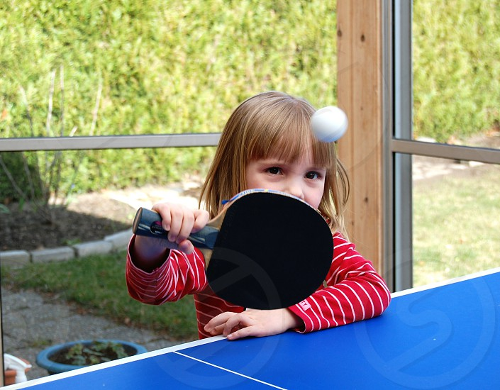 baby girl playing table tennis photo