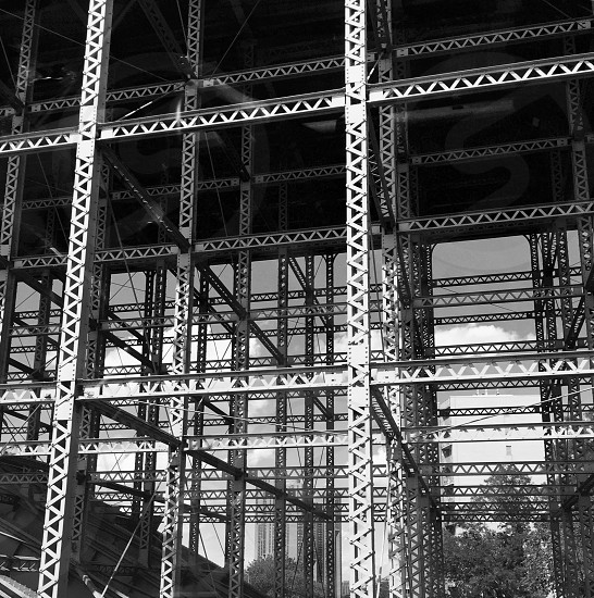 grayscale photo of unfinished building structure photo