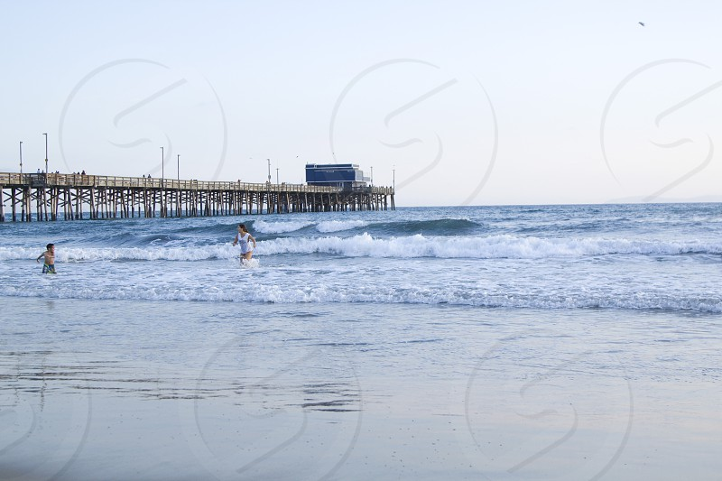 Newport Pier/Mom and Kid Playing in the Ocean - 3 photo