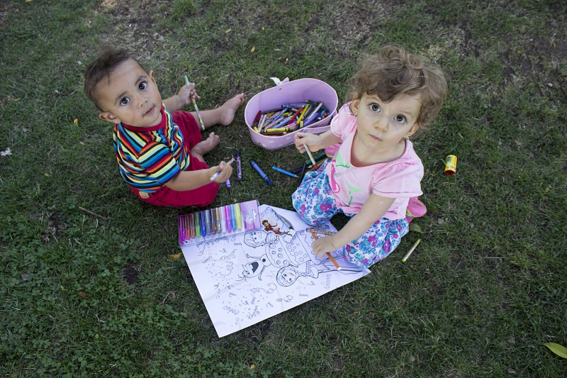Toddlers drawing and painting at the park! photo
