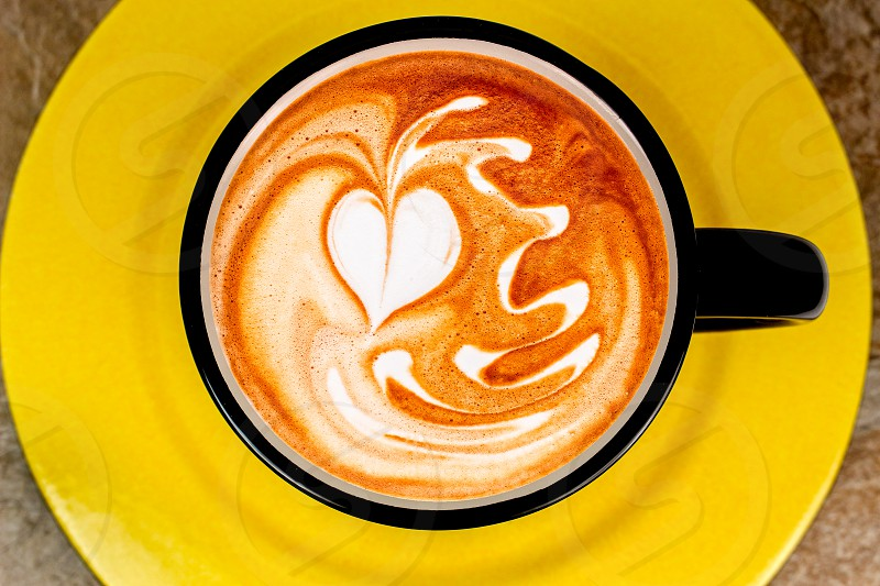 Coffee hot cup yellow cappuccino espresso drink photo