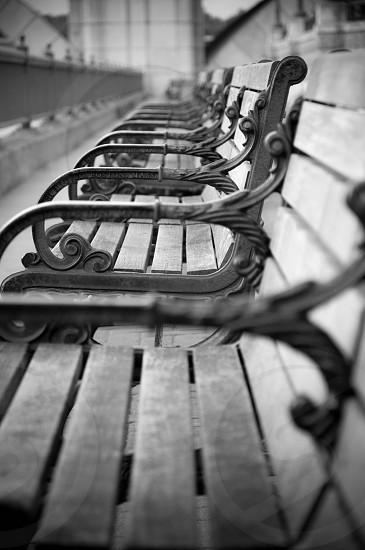 grey metal framed wooden bench photo