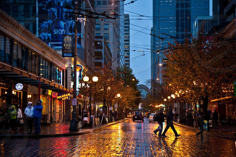 People go about their business in the evening near Pike Place Market in Seattle Washington photo