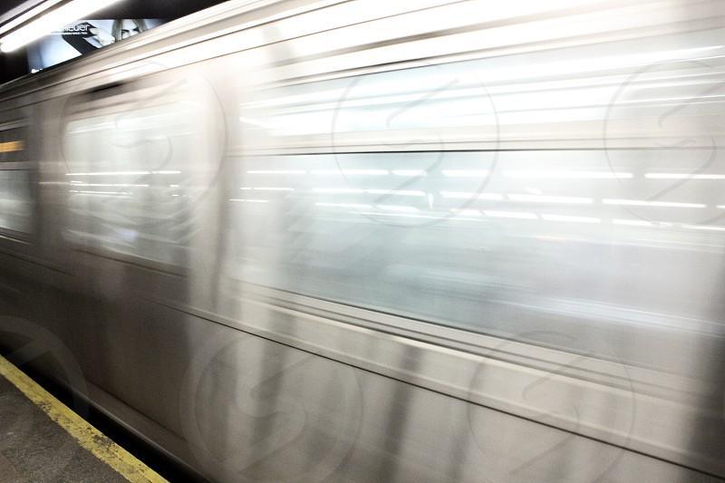 silver subway speeding by the platform time lapse photo photo