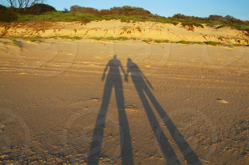 shadow of human on a sand photo
