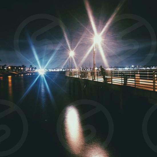 lights shining on boardwalk  photo