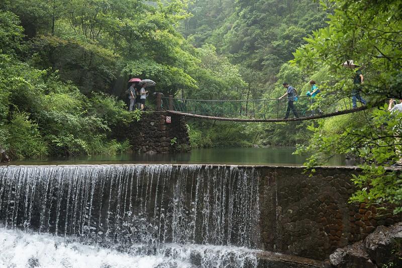China Daqi mountain hangzhou waterfall suspension bridge lake river forest park hiking photo