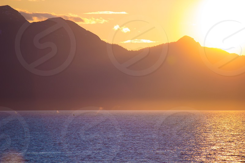 ocean and hill sunrise view photo
