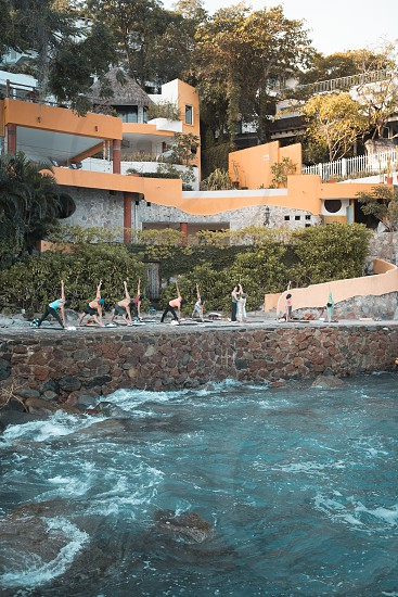 Group of multiple people exercising. Yoga retreat Puerto Vallarta - Mismaloya Mexico photo