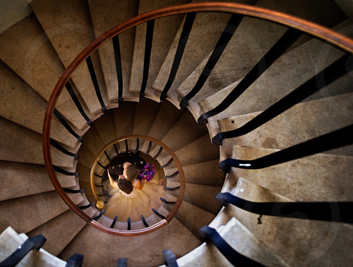 Bride and Groom at bottom of spiral staircase photo