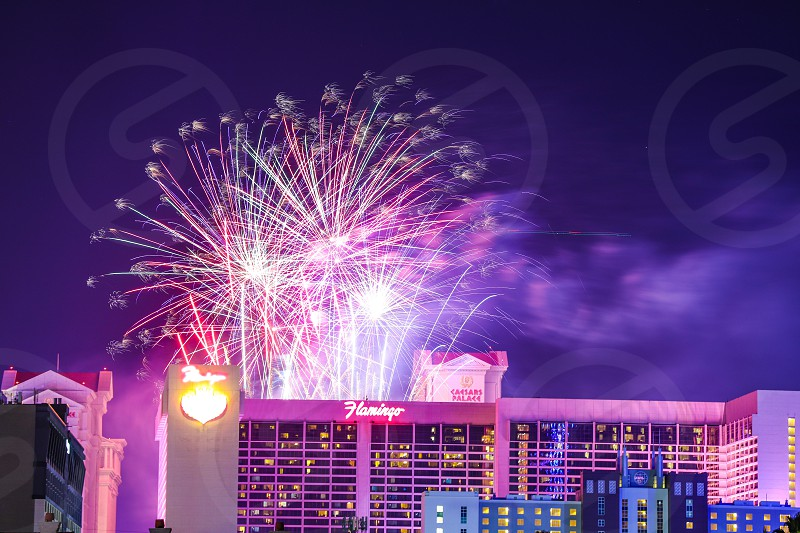 fireworks city night sparkles sparkle celebration holiday festive 4th of July Independence Day New Year's Las Vegas urban buildings scenery scenic long exposure photo