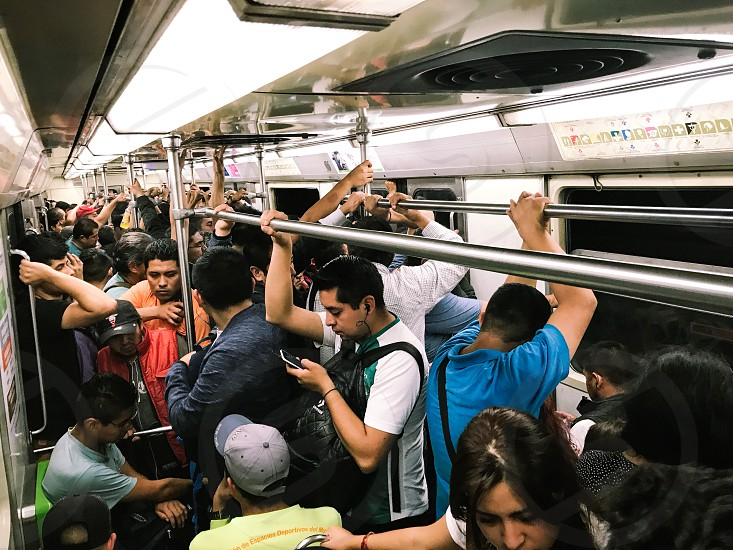 Subway Mexico train metro railway people waiting jr woman station public transportation speed japan transport travel pusher young underground urban man west new platform city moving motion business modern person transit fast movement people using cellular phones photo