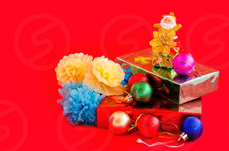 decoration of chritmas and gift box on red background photo