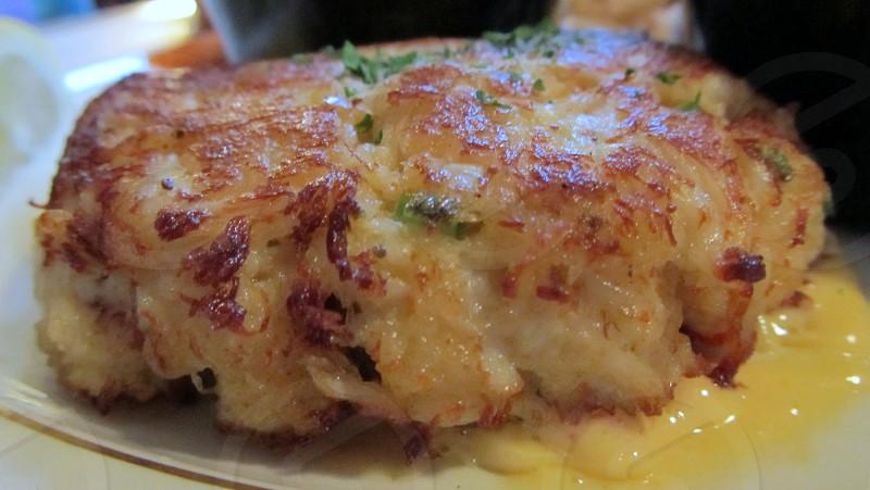 Closeup of crab cake in sauce photo