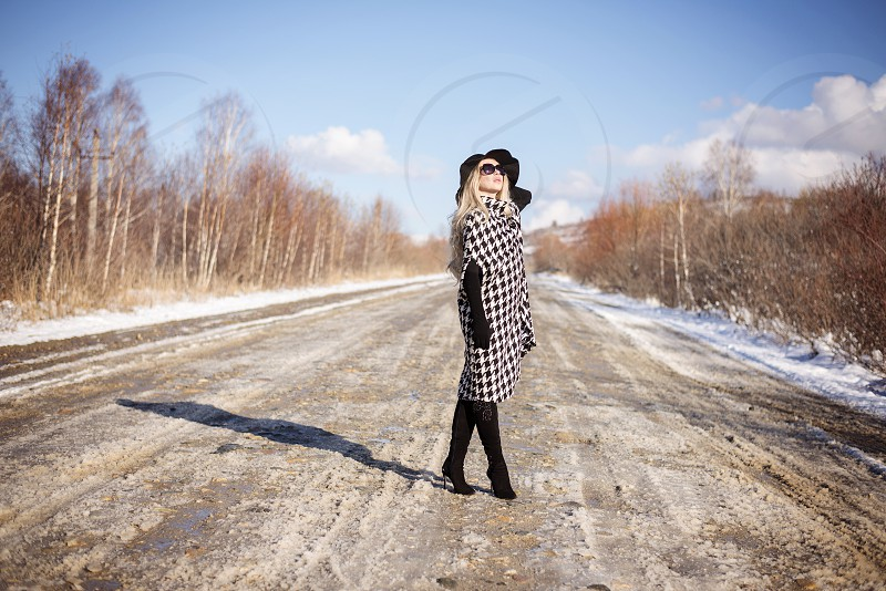 girl in a coat and hat on the road photo