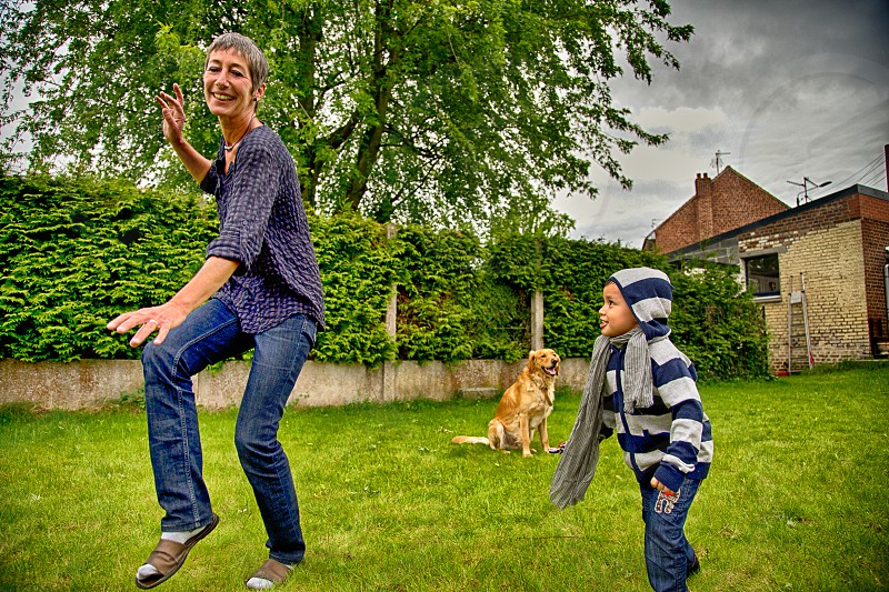 women 50's having fun with grand son in the garden photo