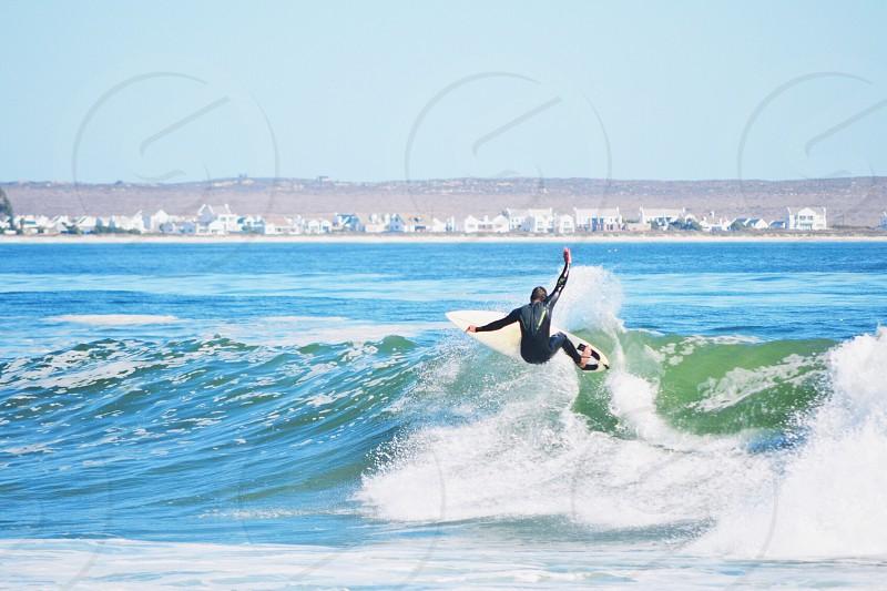 Surfer surfing wave photo