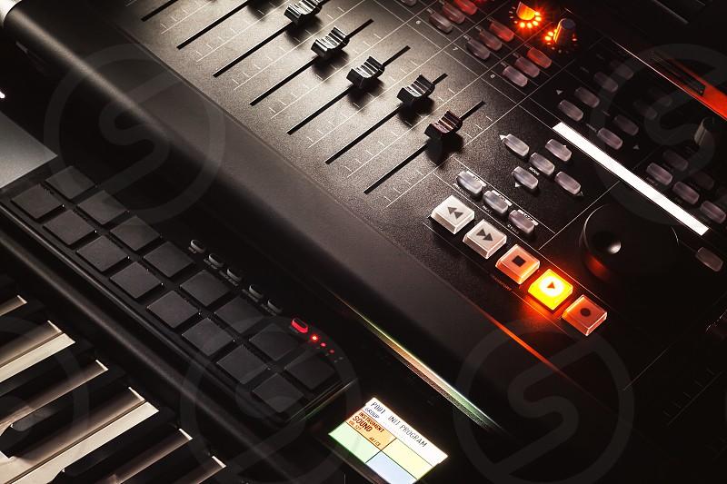 Modern music studio equipment closeup view of mixing console.  photo