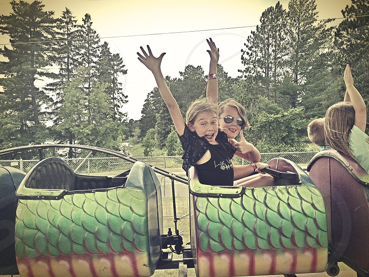 girls in roller coaster photo