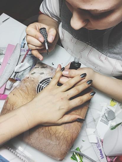 Woman nail artist photo