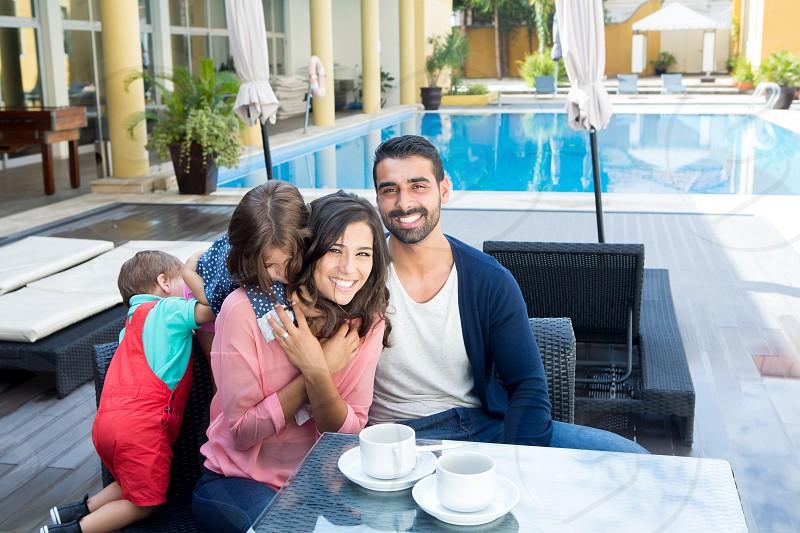 couple family child kid latin hispanic hotel pool photo