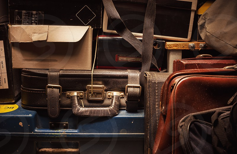 Details of a lot of old and dusty suitcases and boxes.  photo