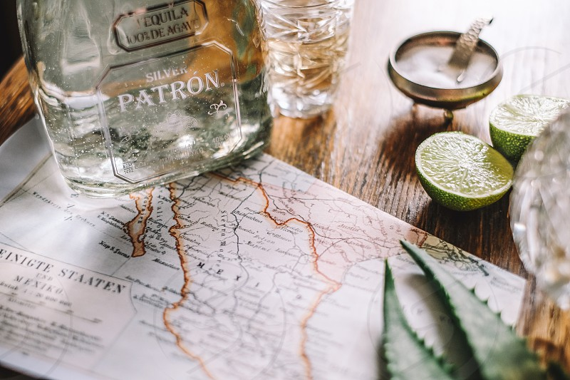 bottle tequila with limes photo