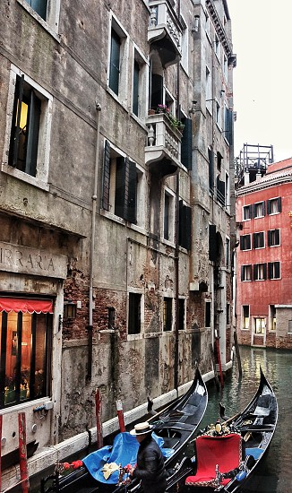 Venician Gondolier in a back alley photo