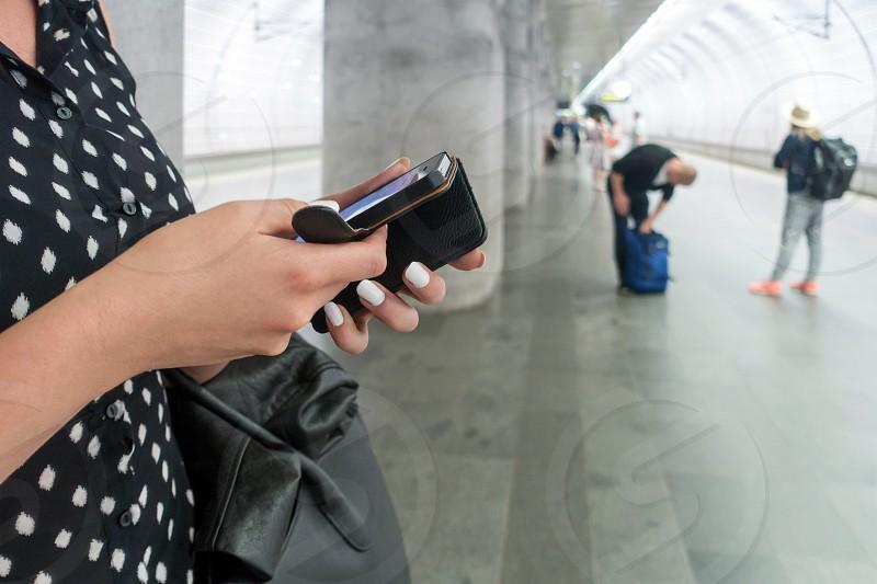 Woman using social media using an iphone photo
