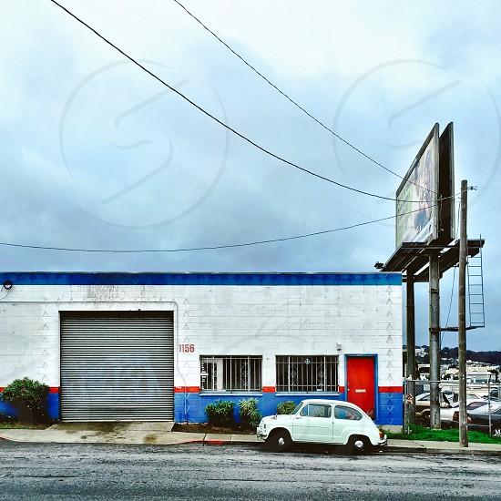 Red white & blue building vintage car photo