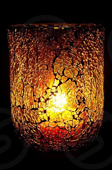 Textured Amber vase with candle burning. photo
