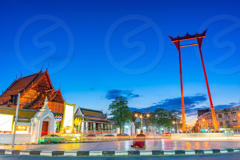 The Giant Swing (Sao Ching Cha) with long exposure light at the evening in Bangkok Thailand. photo