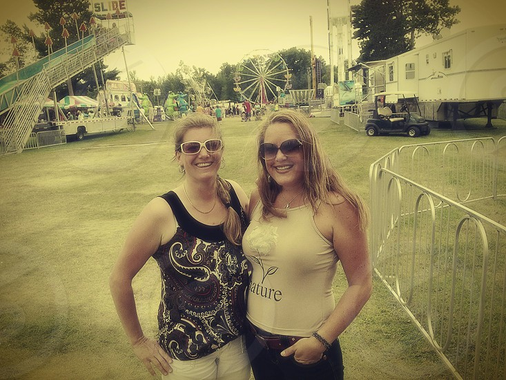 two woman in tank tops photo