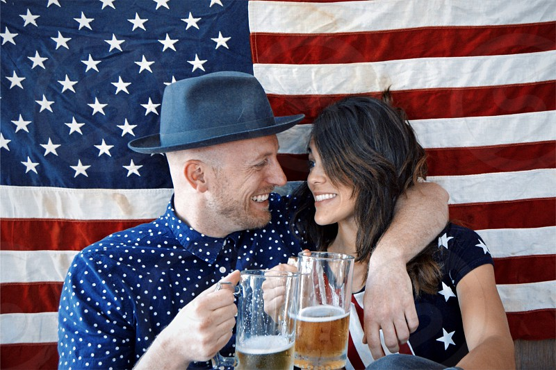 Couple enjoying beer America flags Independence Day holiday Fourth of July  photo