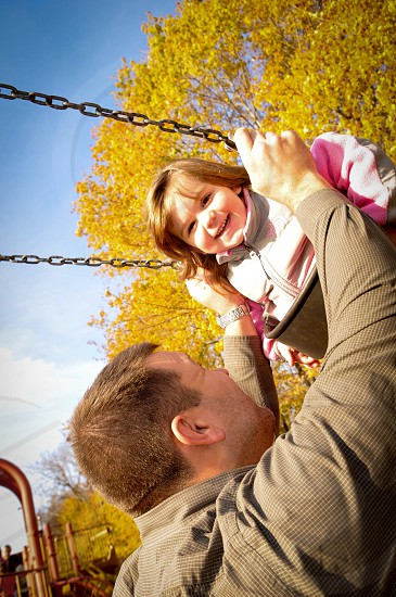happy family dad daughter playing at the park photo